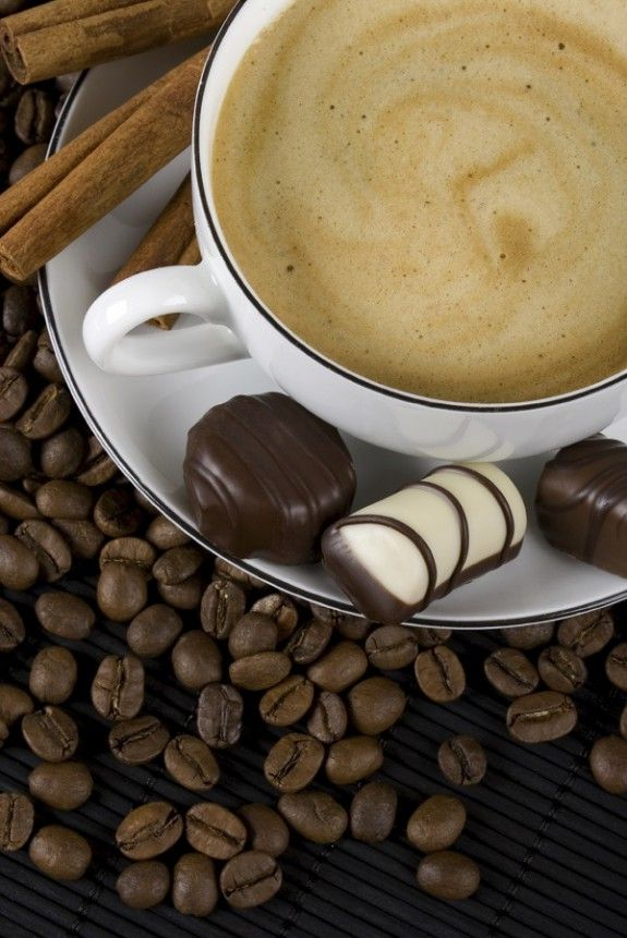 Cup of espresso coffee with chocolate candies
