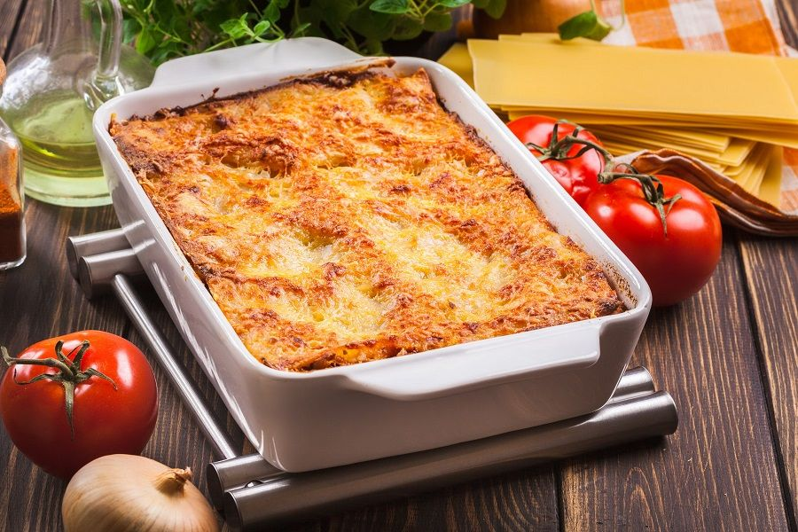 66997651 - hot tasty lasagna in ceramic casserole dish