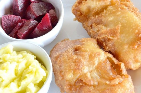 94272690 - traditional greek dish of fried cod fish fillet, garlic dip, known as skordalia and roasted beet salad