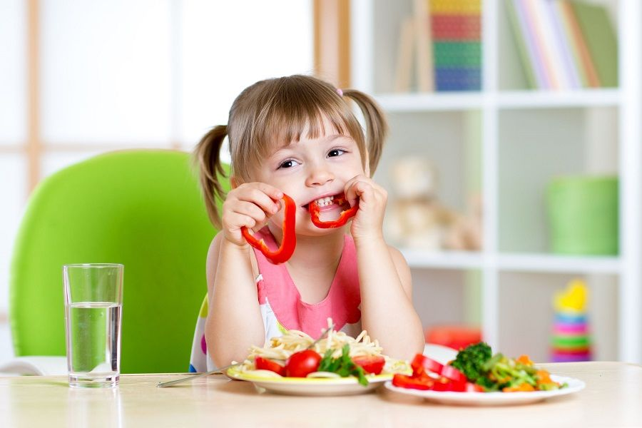 44154444 - child eating healthy food in kindergarten or at home