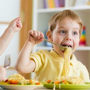 35418213 - kids eating food in nursery or at home