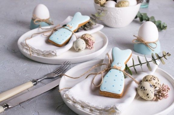 96751241 - homemade easter cookies in the shape of  a  funny  rabbit  on white plate. easter  festive table setting. holiday decorations.