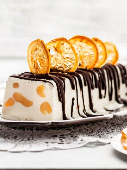 97161287 - lemon curd semifreddo, ice cream cake decorated with chocolate and candied lemon slices