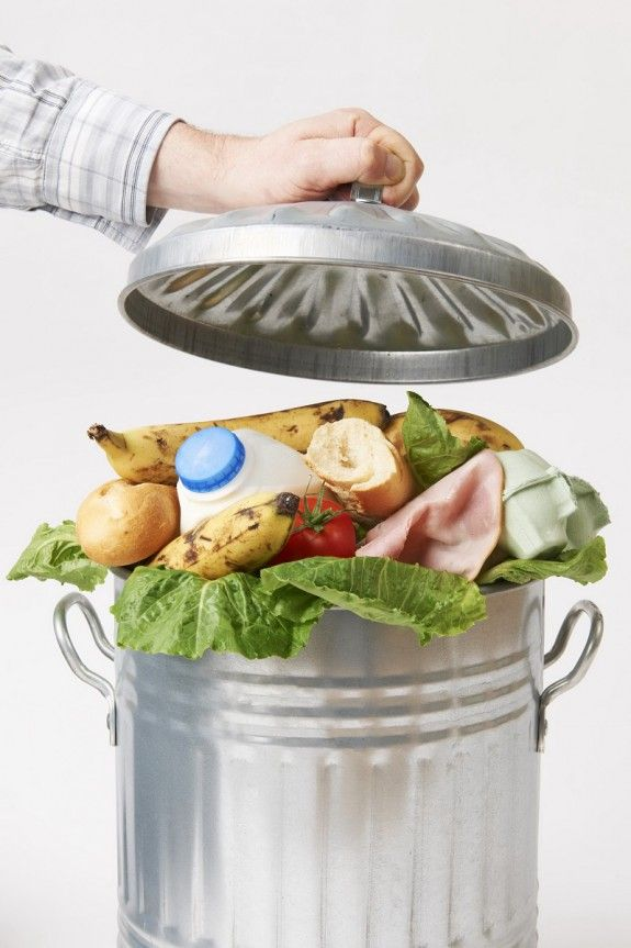 49370185 - hand putting lid on garbage can full of waste food
