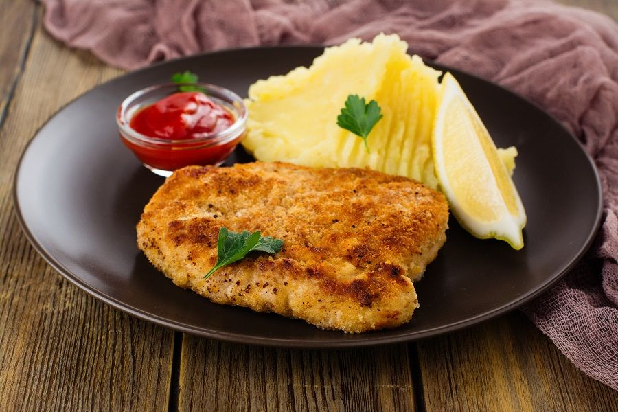 77378622 - turkey schnitzel with mashed potatoes, tomato sauce