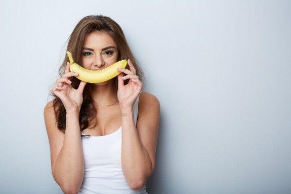 woman making fun with a banana