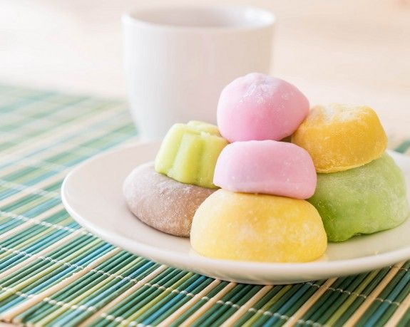 colorful dessert mochi on white plate