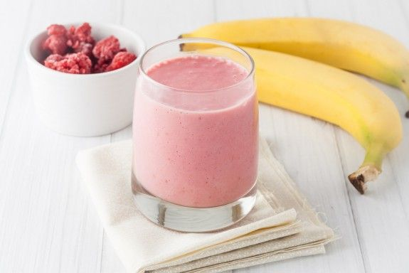 a glass of fresh homemade frozen raspberries and banana smoothie